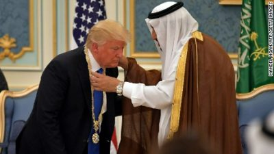 Trump lands in Saudi Arabia as controversies swirl at home
