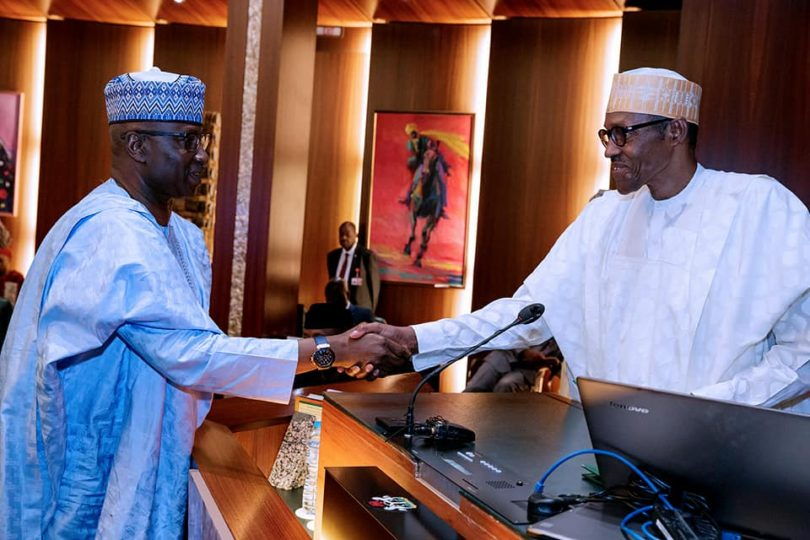 Buhari-handshakes-Boss-Mustapha.jpg