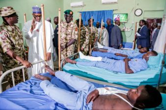 Don't be distracted by speculations, remain focused, committed to task of eliminating Boko Haram from surface of earth, Nigeria's President encourages troops, visits wounded soldiers in hospital
