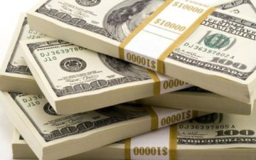 Dollar steady, unfazed by Trump address