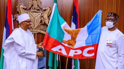 President Buhari meets, presents Osagie Ize-Iyamu with APC flag inside State House