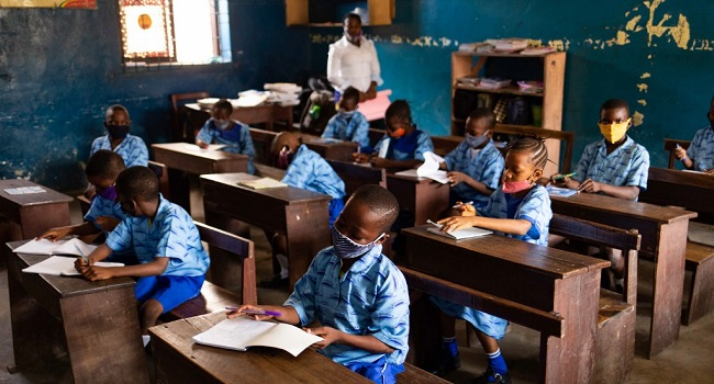 Students-of-Rising-Sun-Children-School-wear-face-masks-as-a-preventive-measure-to-curb-the-spread-of-the-COVID-19-coronavirus-in-their-classroom-in-Yaba.jpg