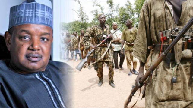 Kebbi-Governor-Atiku-Bagudu-and-local-hunters.png